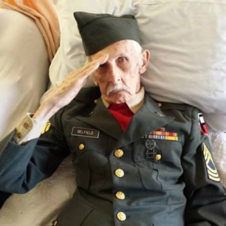A 98-year-old WWII veteran passes away the way he wanted, with his wife by his side and dressed in his army uniform. This picture of Justus Belfield saluting was taken Nov. 12, 2014 before he died. He served our country for 17 years.