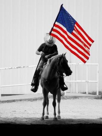Cowboy bows his head